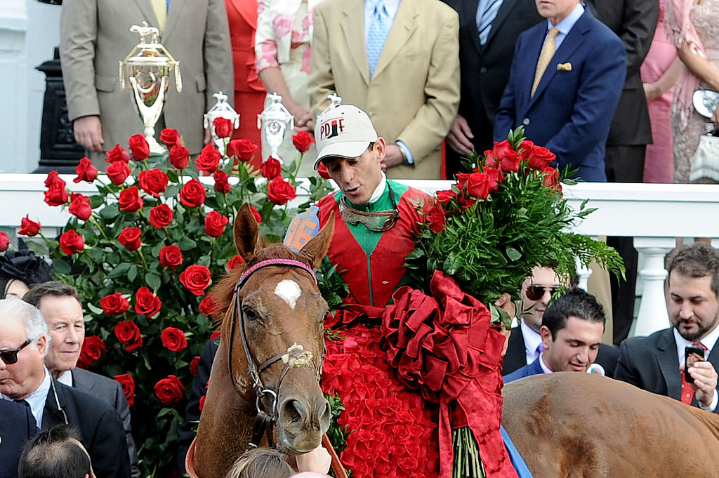 A horse wears a blanket of roses