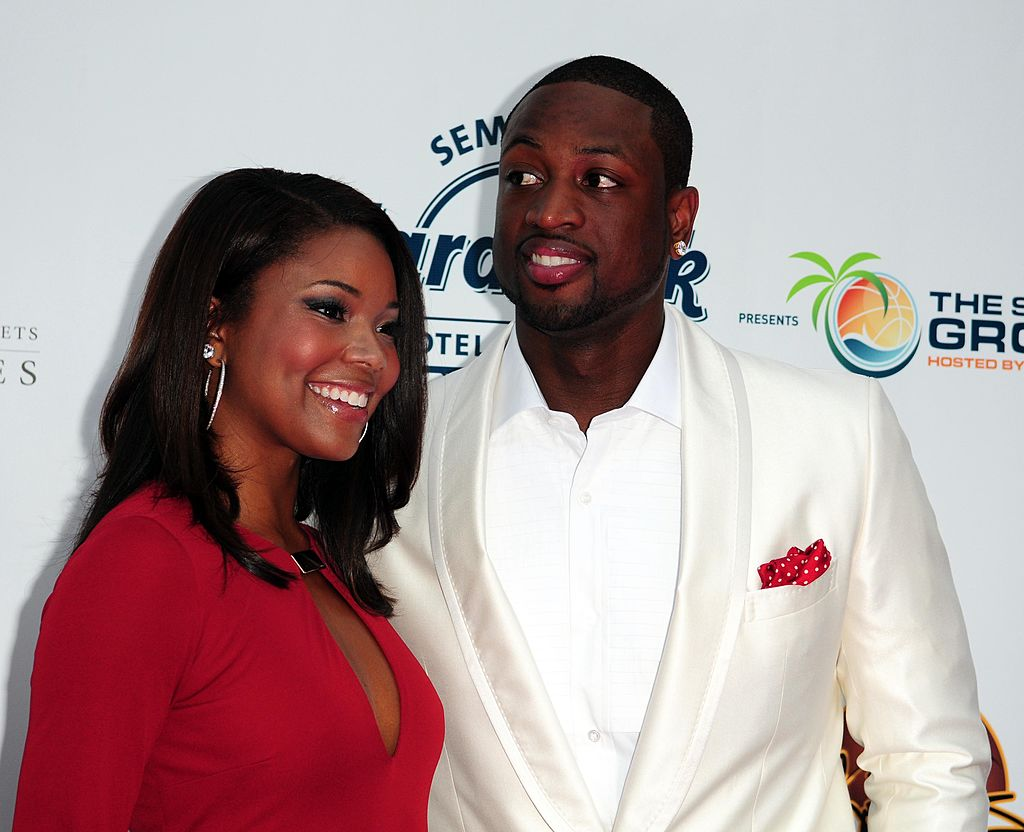 Gabrielle Union and Dwyane Wade attends Summer Groove Benefit Dinner -103065506