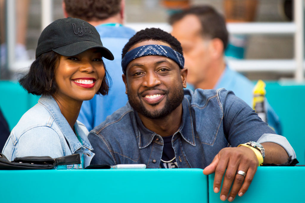 Miami Heat basketball player Dwayne Wade and his wife Gabrielle Union smile-1052134902