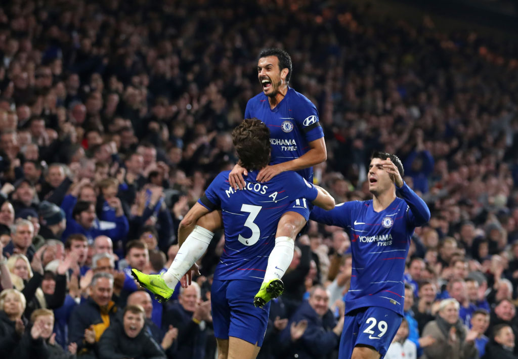 Chelsea FC celebrates with teammates Marcos Alonso and Alvaro Morata after scoring his team's third goal