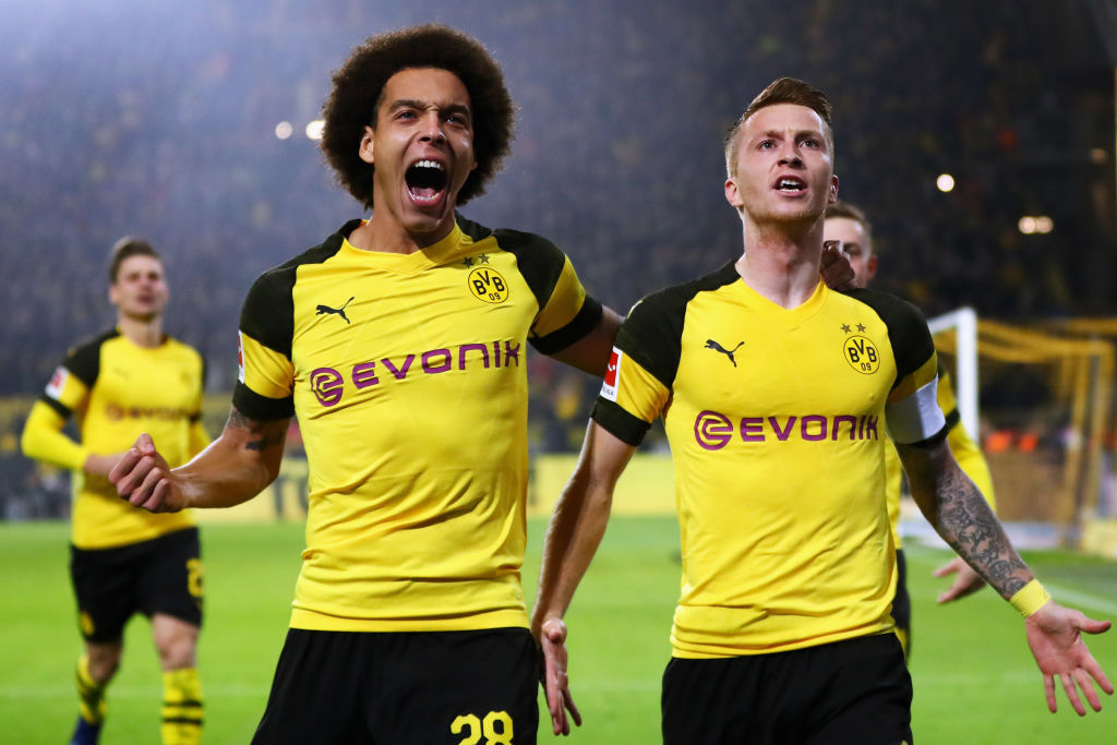 Borussia Dortmund celebrates with teammate Axel Witsel after scoring his team's first goal