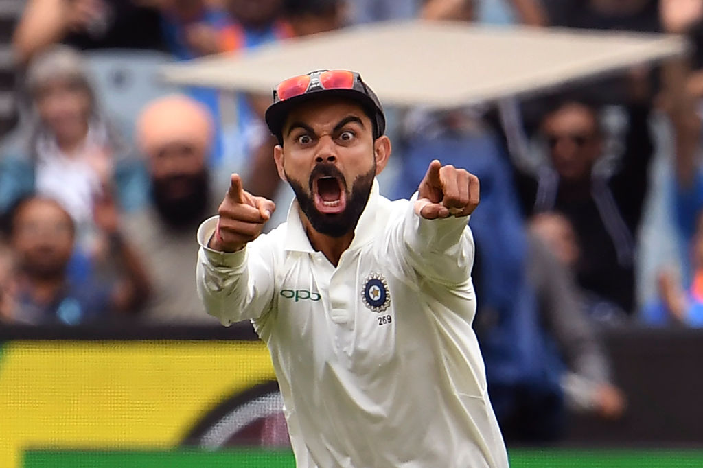 Virat Kohli celebrates the wicket of Australia's Pat Cummins on the final day of the third cricket Test match between Australia and India