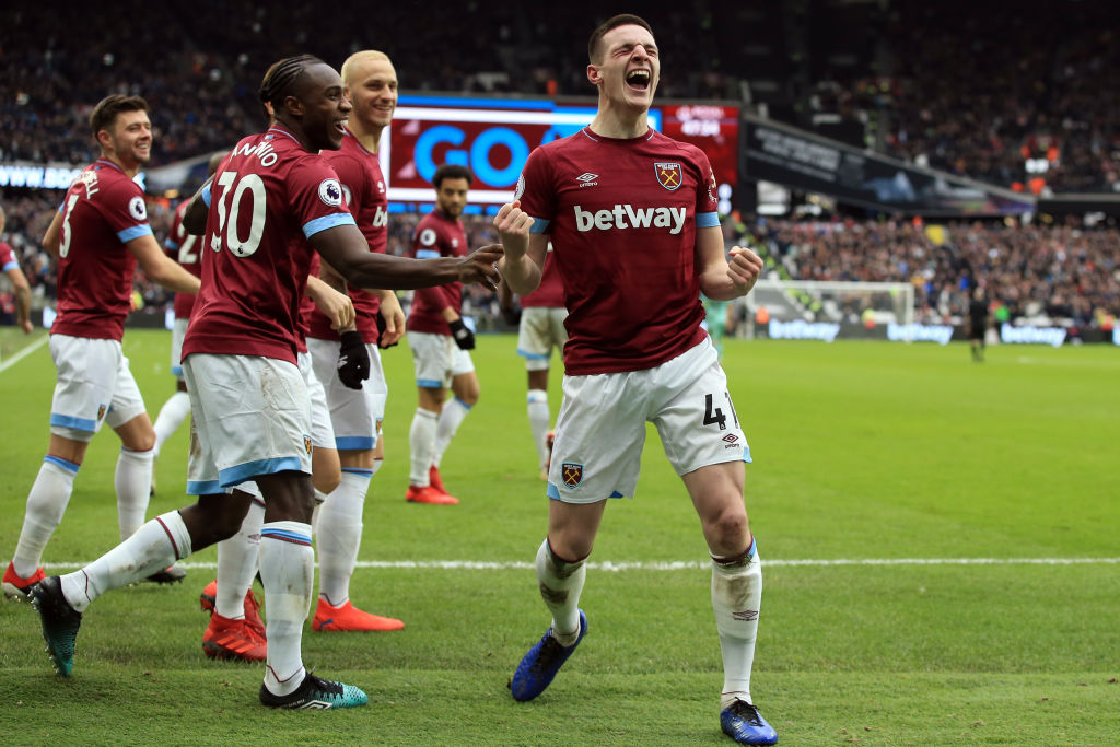 Declan Rice of West Ham United celebrates scoring the winning goal with team mates during the Premier League