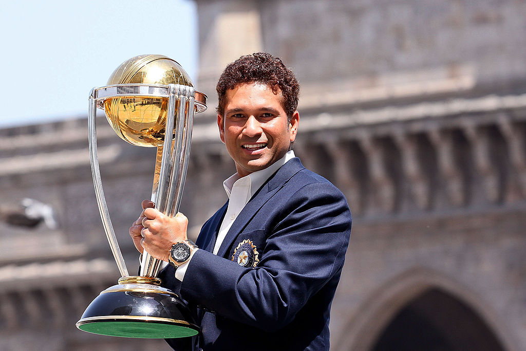Sachin Tendulkar poses with the ICC Cricket World Cup Trophy