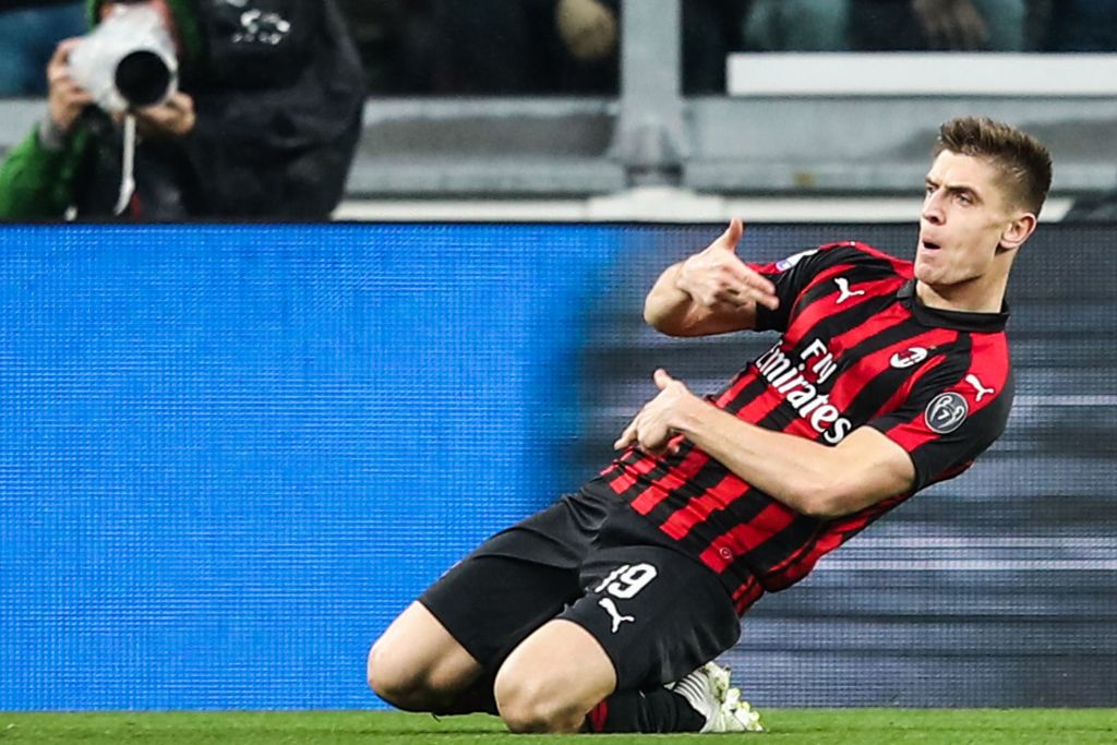 AC Milan Polish forward Krzysztof Piatek celebrates after opening the scoring during the Italian Serie A football match