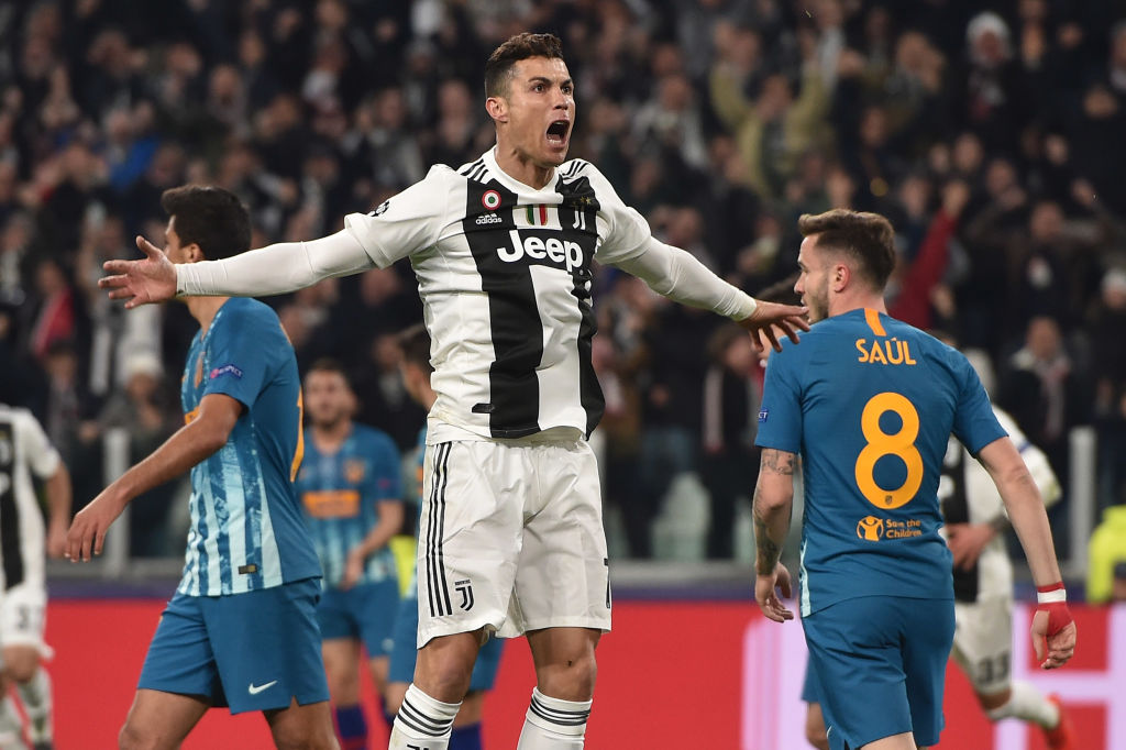 Juventus FC celebrates after scoring the opening goal during the UEFA Champions League Round