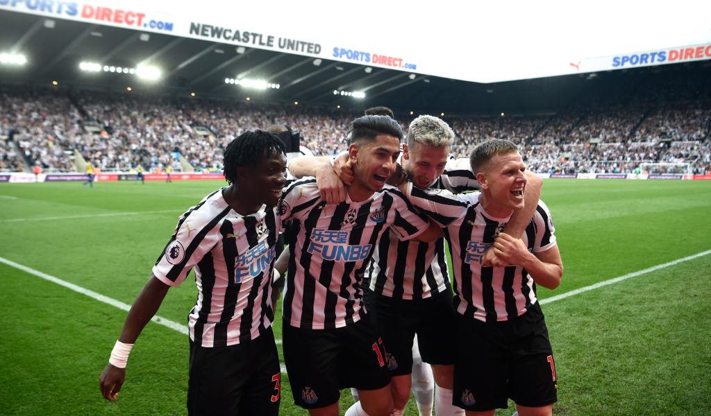 Newcastle United striker Ayoze Perez celebrates his hat trick goal with teammates