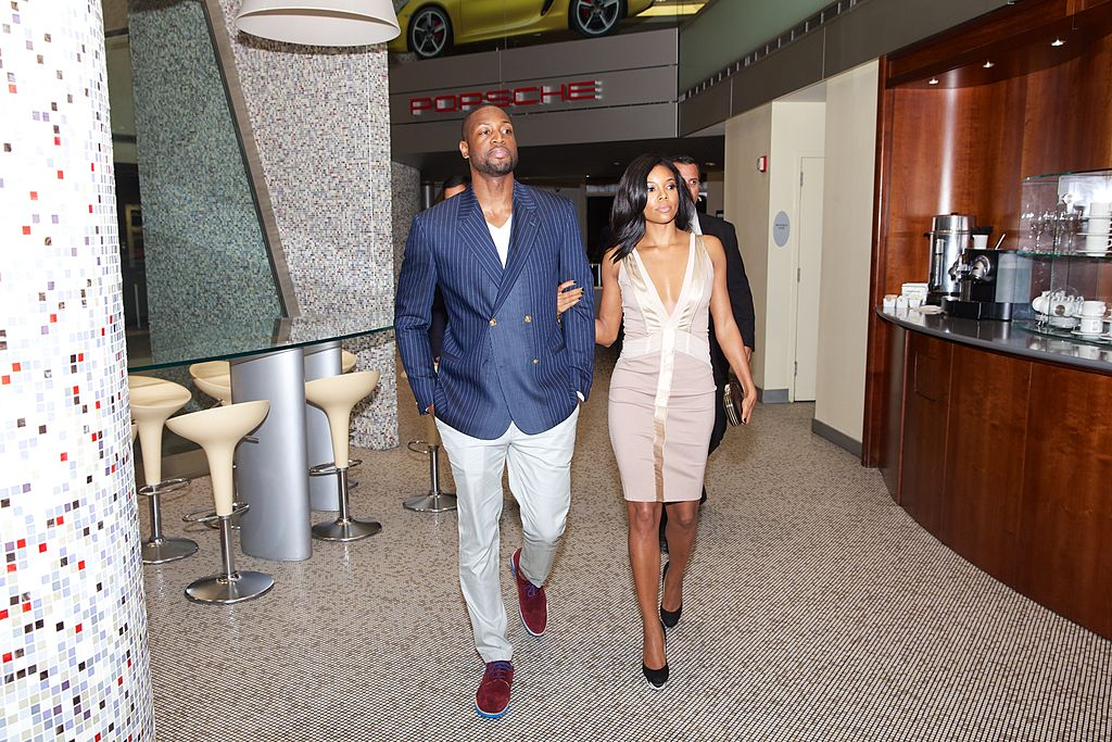 Dwyane Wade and Gabrielle Union enjoys a moment at THE COLLECTION -451293937