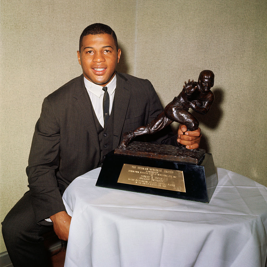 Ernie Davis  holds the 1961 Heisman Trophy with which he was presented here 12/6
