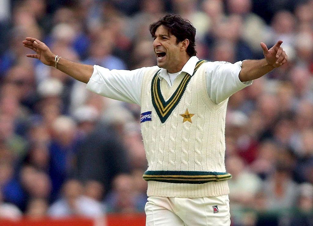 Wasim Akram celebrates the runout of England batsman Graham Thorpe