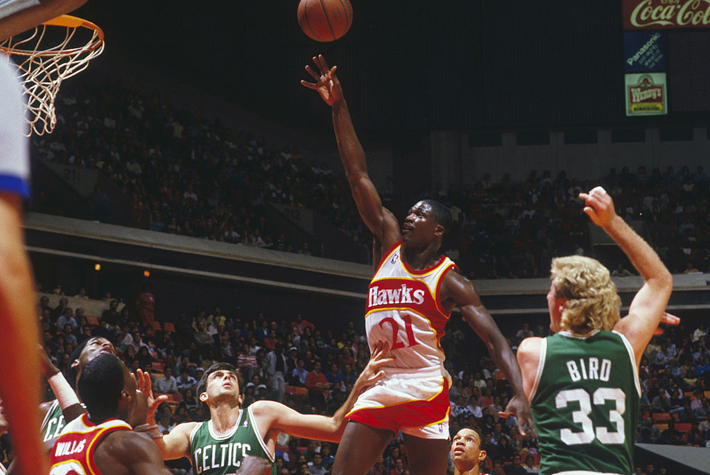 Dominique Wilkins jumps for a layup against the Boston Celtics