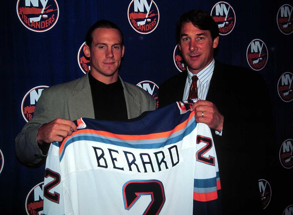 Bryan Berard signs his contract to play for the New York Islanders