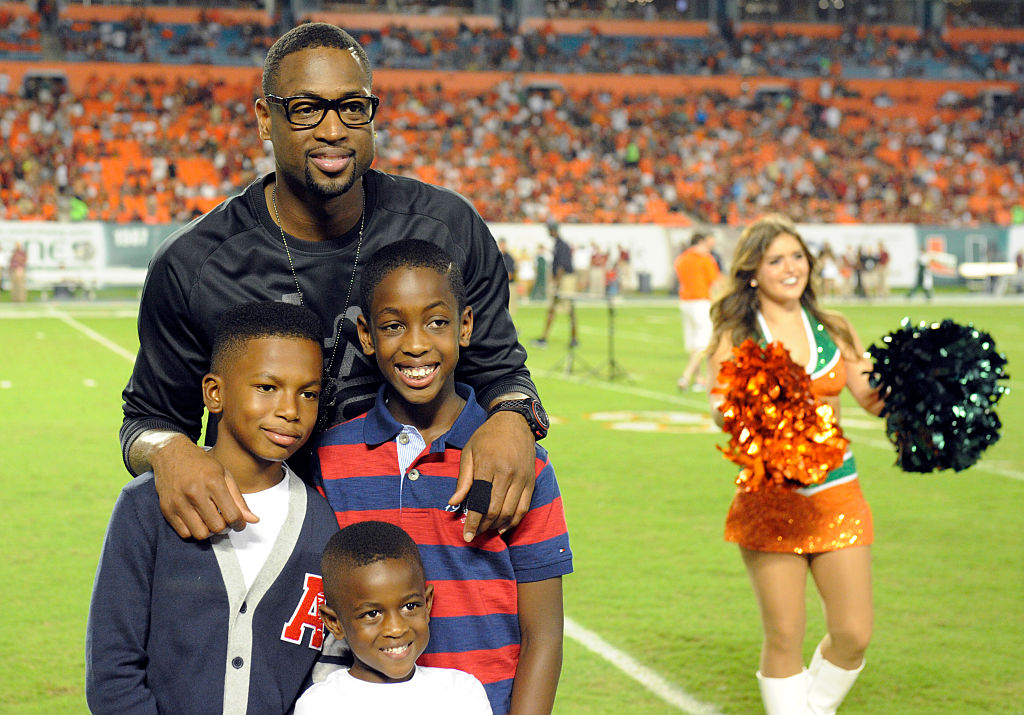 Miami HEAT player Dwyane Wade poses with his children on the sidelines-576942506