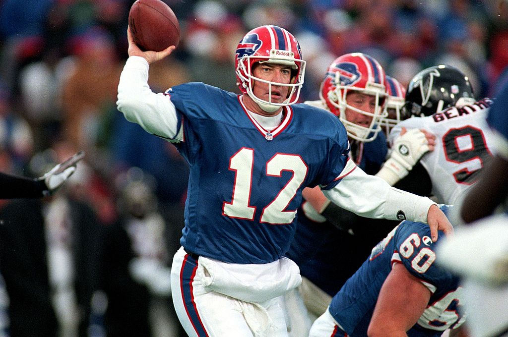 Jim Kelly gets ready to pass the ball during the game against the Atlanta Falcons