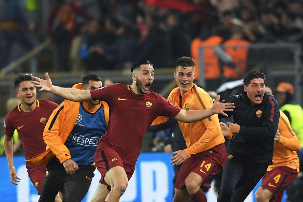 AS Roma's Greek defender Kostas Manolas (C) celebrates after scoring a goal