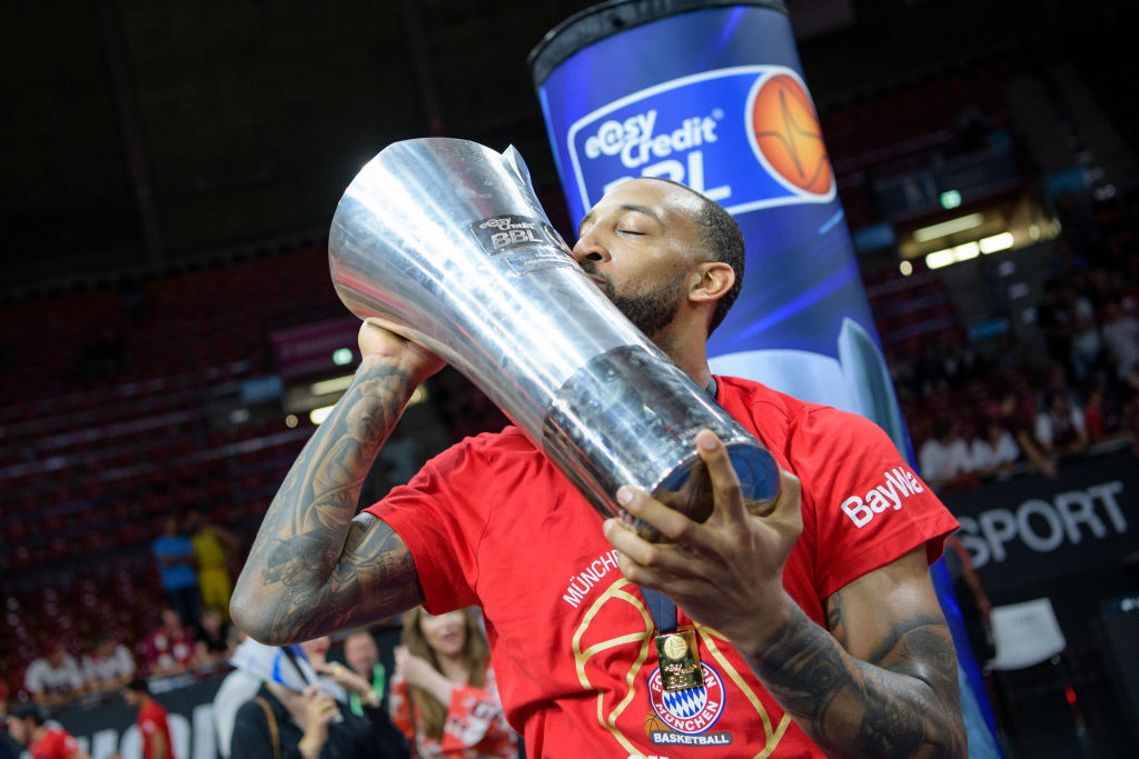 Derrick Williams of Munich kisses the trophy