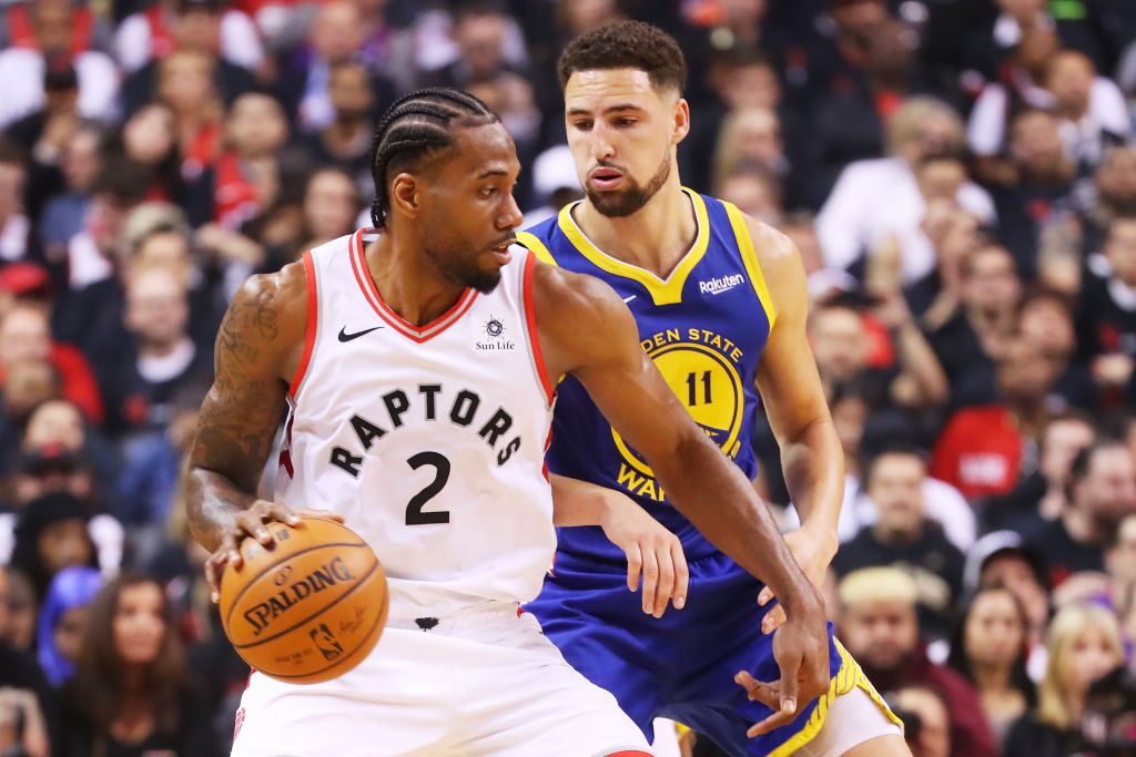 Kawhi Leonard #2 of the Toronto Raptors is defended by Klay Thompson #11 of the Golden State Warriors in the second quarter during Game One of the 2019 NBA Finals