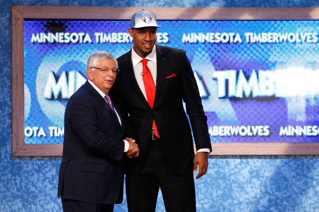 Derrick Williams from Arizona greets NBA Commissioner David Stern after he was selected #2 overall by the Minnesota Timberwolves in the first round-117158262