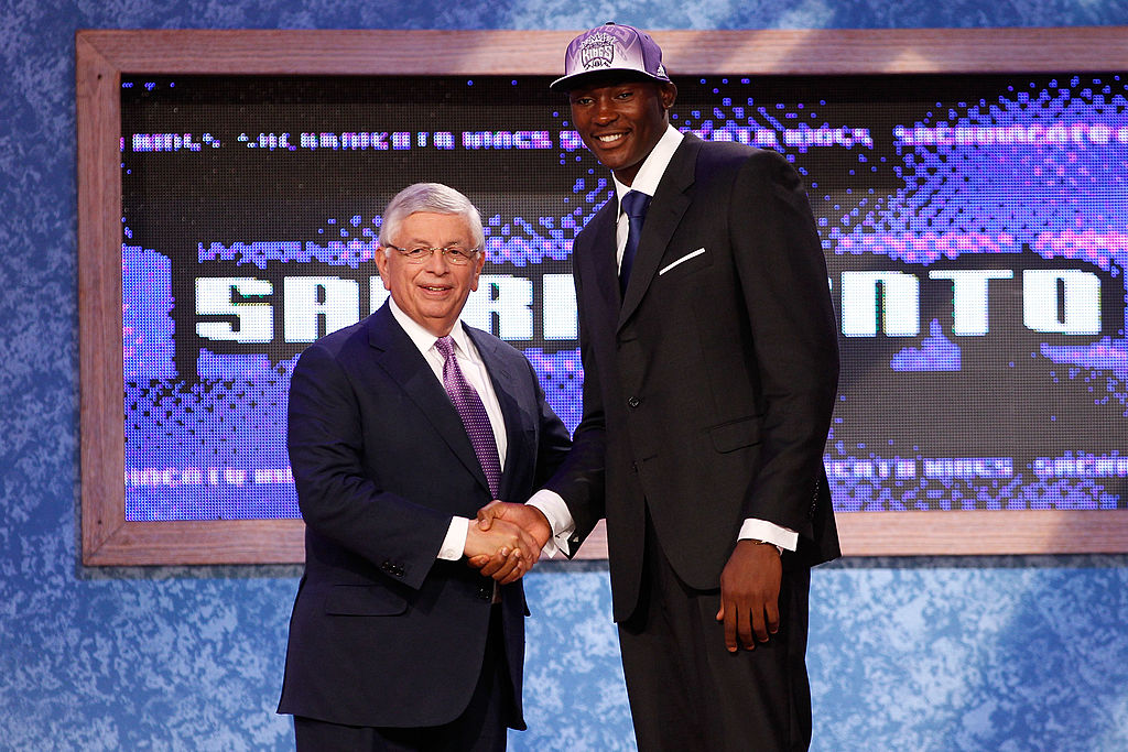 Bismack Biyombo from the Congo greets NBA Commissioner David Stern after he was picked #7 overall by the Sacramento Kings in the first round -117159329