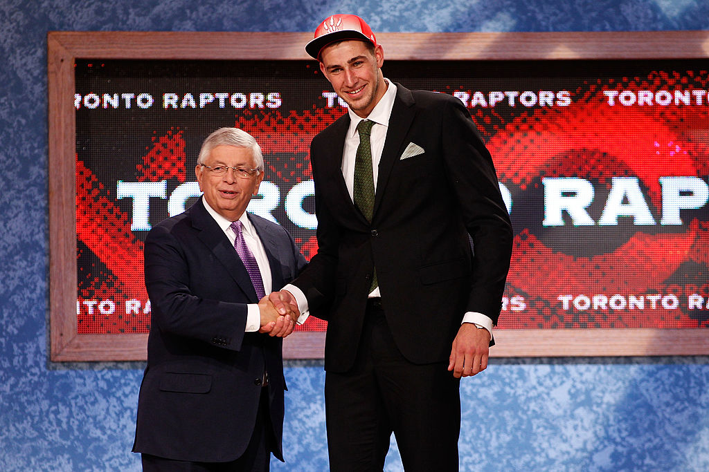 Jonas Valanciunas (R) from Utena, Lithuania greets NBA Commissioner David Stern after he was picked #5 overall by the Toronto Raptors-117159350
