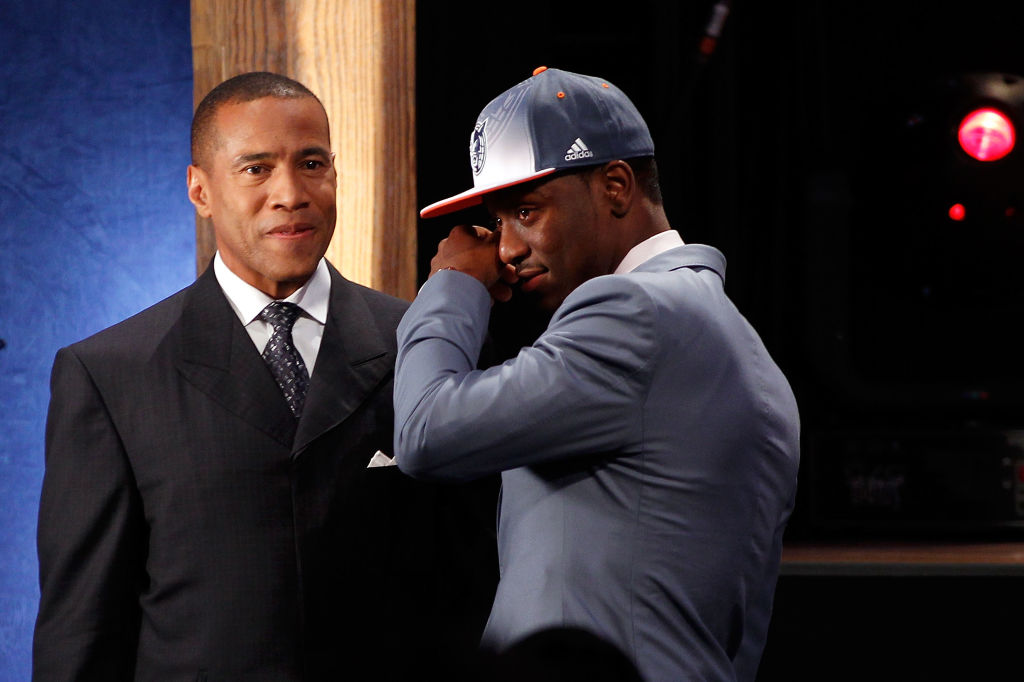 Kemba Walker from UCONN is overcome with emotion while he is interviewed by Mark Jones after he was selected #9 overall by the Charlotte Bobcats-117160931