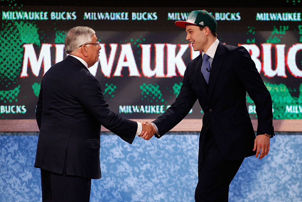 Jimmer Fredette from BYU greets NBA Commissioner David Stern after he was selected #10 overall by the Milwaukee Bucks in the first round-117160948