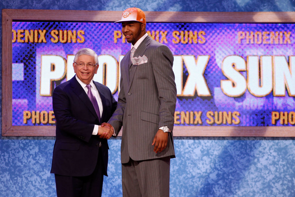 Markieff Morris from the Kansas Jayhawks greets NBA Commissioner David Stern after he was drafted #13 overall by the Phoenix Suns -117161551