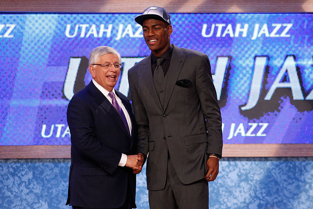 Alec Burks from the Colorado Buffalos greets NBA Commissioner David Stern after he was selected #12 overall by the Utah Jazz-117163242