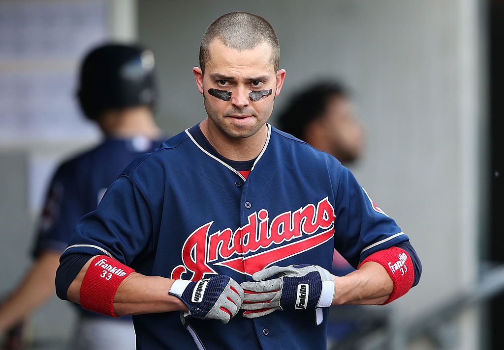 Nick Swisher #33 of the Cleveland Indians walks in the dugout after striking out in the sixth inning of the game against the Detroit Tigers at Comerica Park on June 8, 2013 in Detroit, Michigan. The Tigers defeated the Indians 6-4-170197637