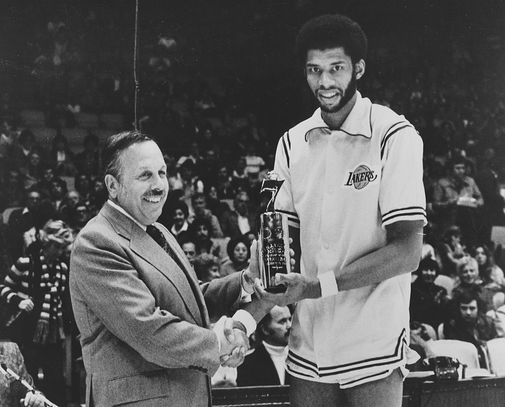 Publicity photo of Kareem Abdul-Jabbar and Mel Elliot receiving an award at Los Angeles Forum during the Seagrams Seven Crowns of Sports competition-499765447