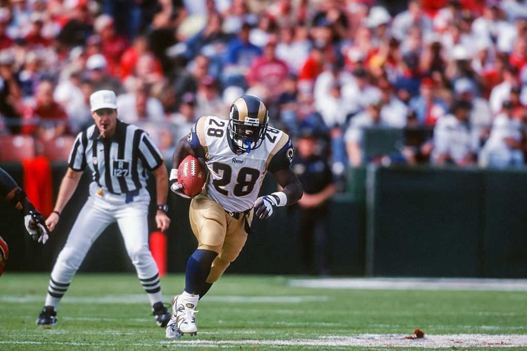 Marshall Faulk #28 of the Los Angeles Ram carries the ball during a National Football League game against the San Francisco 49ers played-531354642