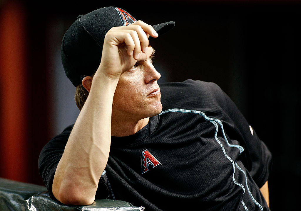 Zack Greinke #21 of the Arizona Diamondbacks looks on from the dugout before the start of a MLB game against the Los Angeles Dodgers at Chase Field on July 15, 2016 in Phoenix, Arizona-577815832