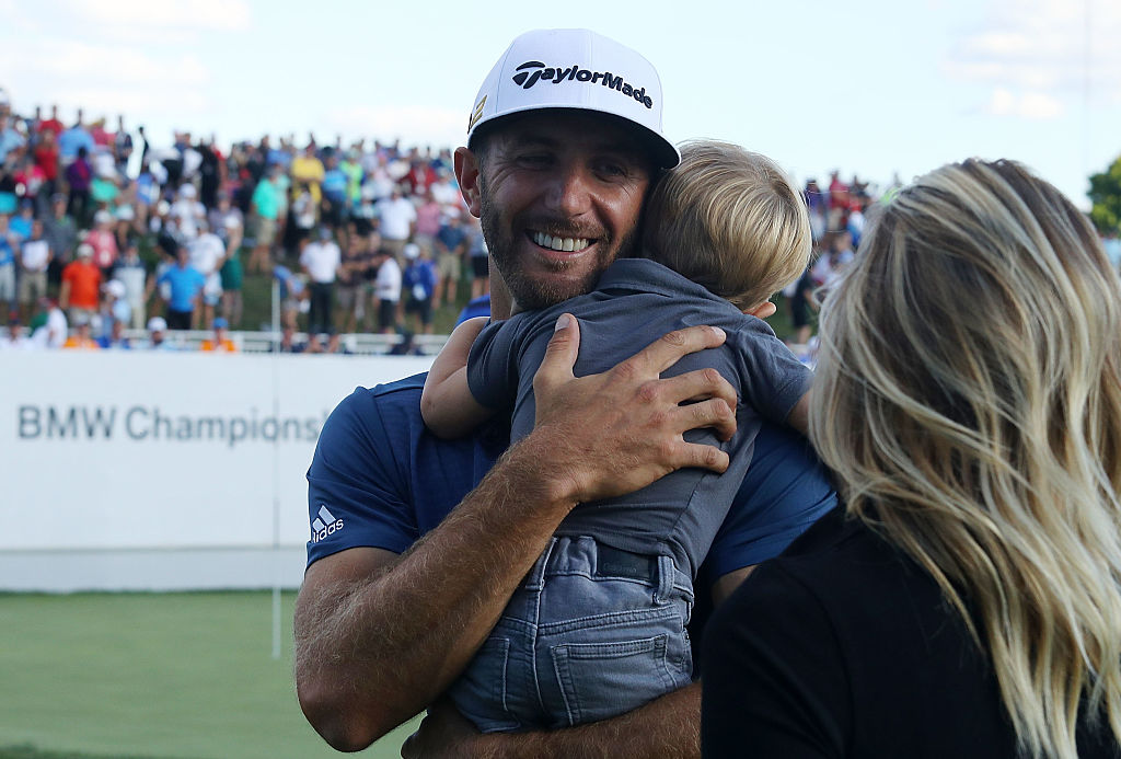 dustin johnson and his son after winning a tournament