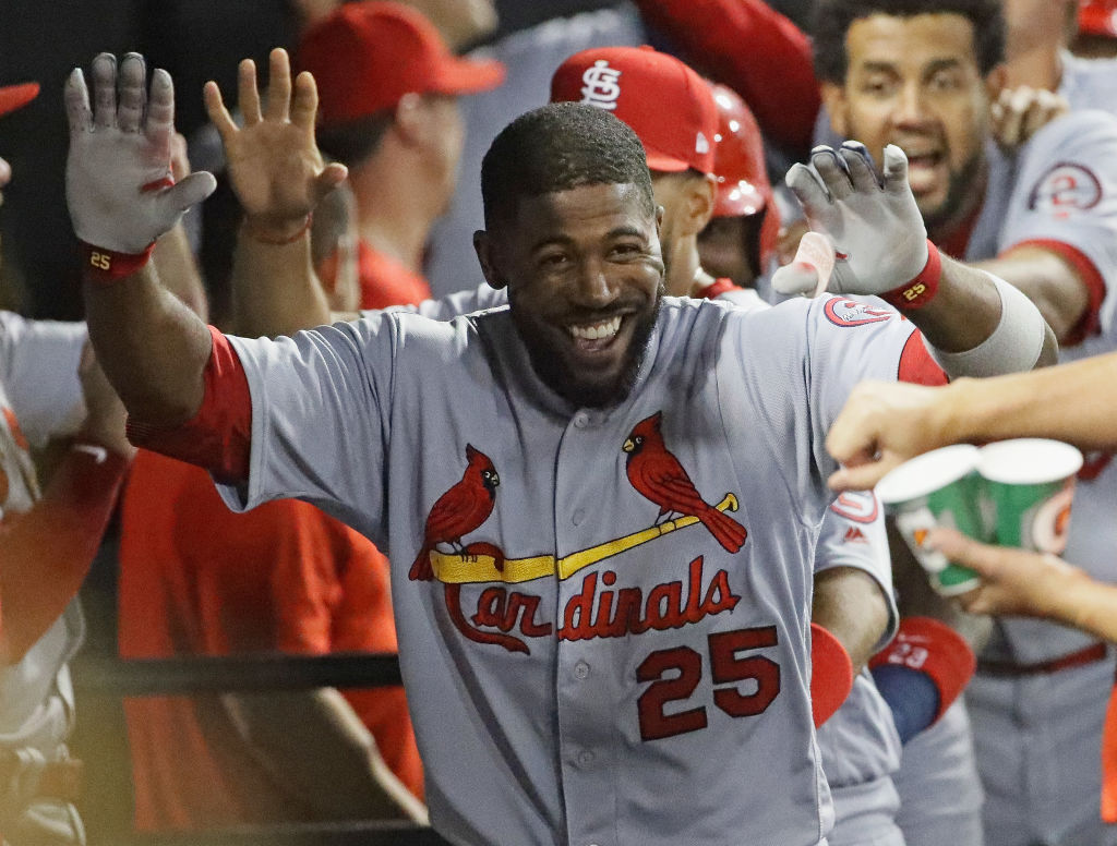Dexter Fowler #25 of the St. Louis Cardinals celebrates in the dugout after hitting a grand slam home run in the 6th inning against the Chicago White Sox at Guaranteed Rate Field on July 10-995773460