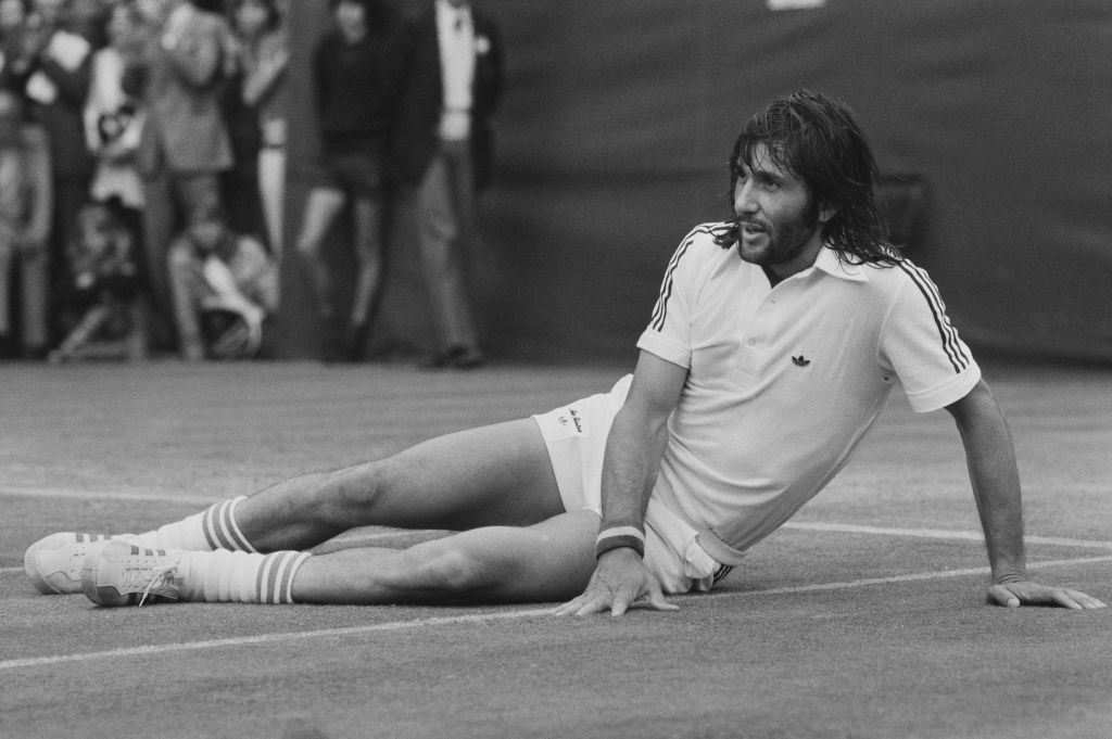 Nastase reclines on the court