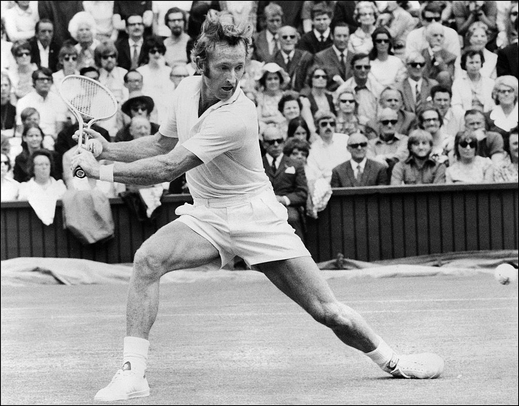 Australian tennis player Rod Laver stretches to reach a ball