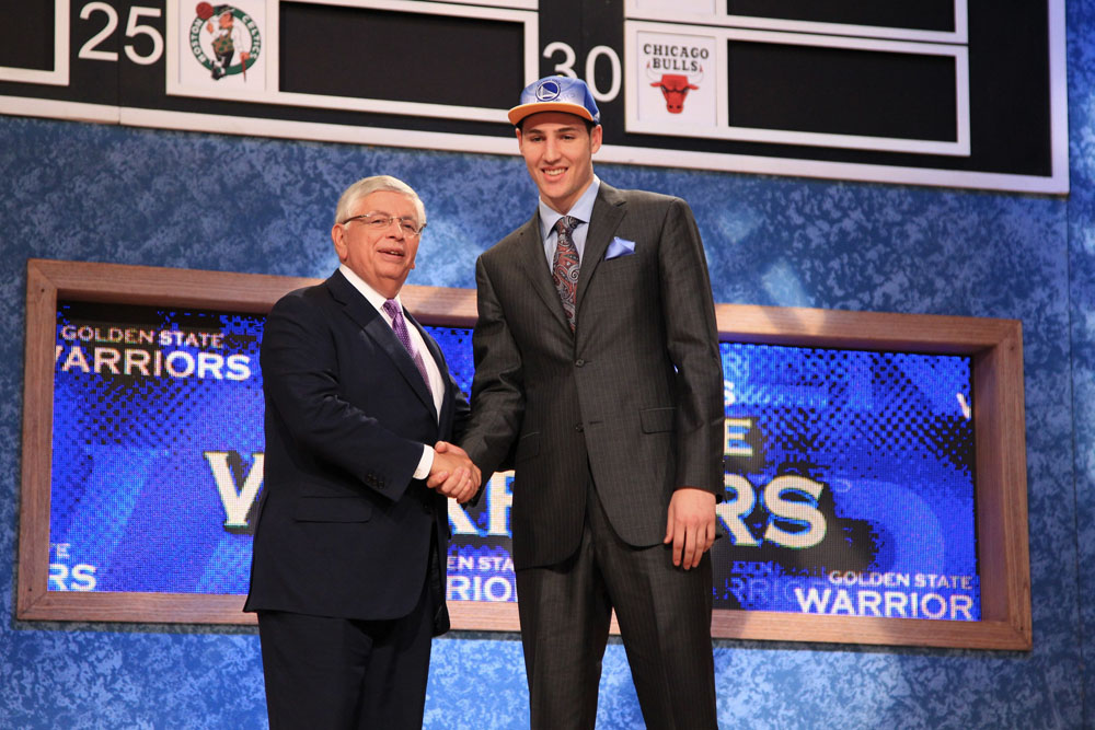 klay Thompson shakes hands with NBA Commissioner David Stern after being selected number eleven overall by the Golden State Warriors