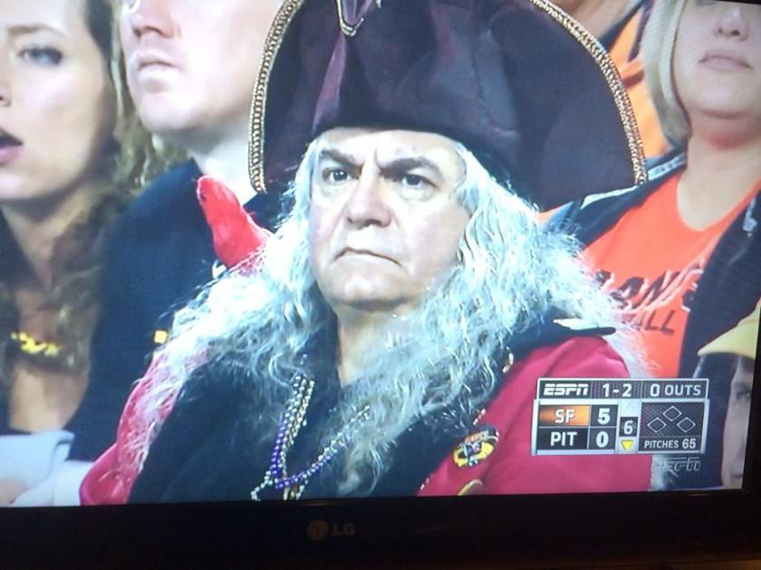 a pirates fan at a baseball game