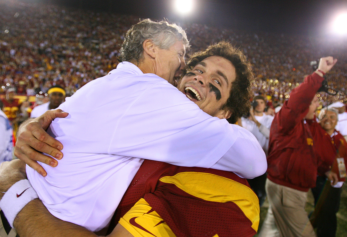USC head coach Pete Carroll and qauterback Matt Leinert celebrate their victory over UCLA at the Co
