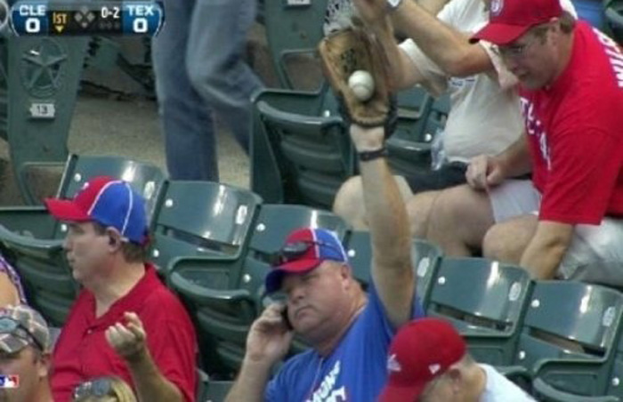 fan on the phone while catching a foul ball