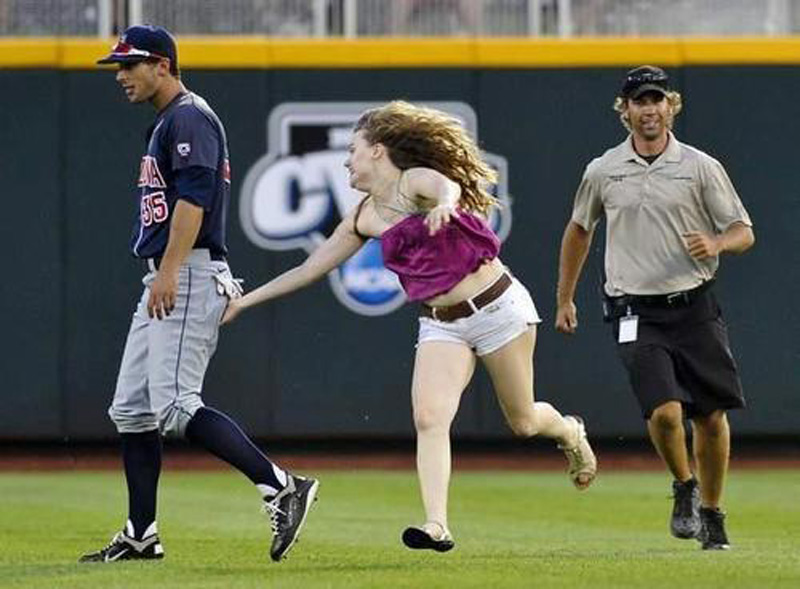 a female fan ran onto the field to grab players' butts