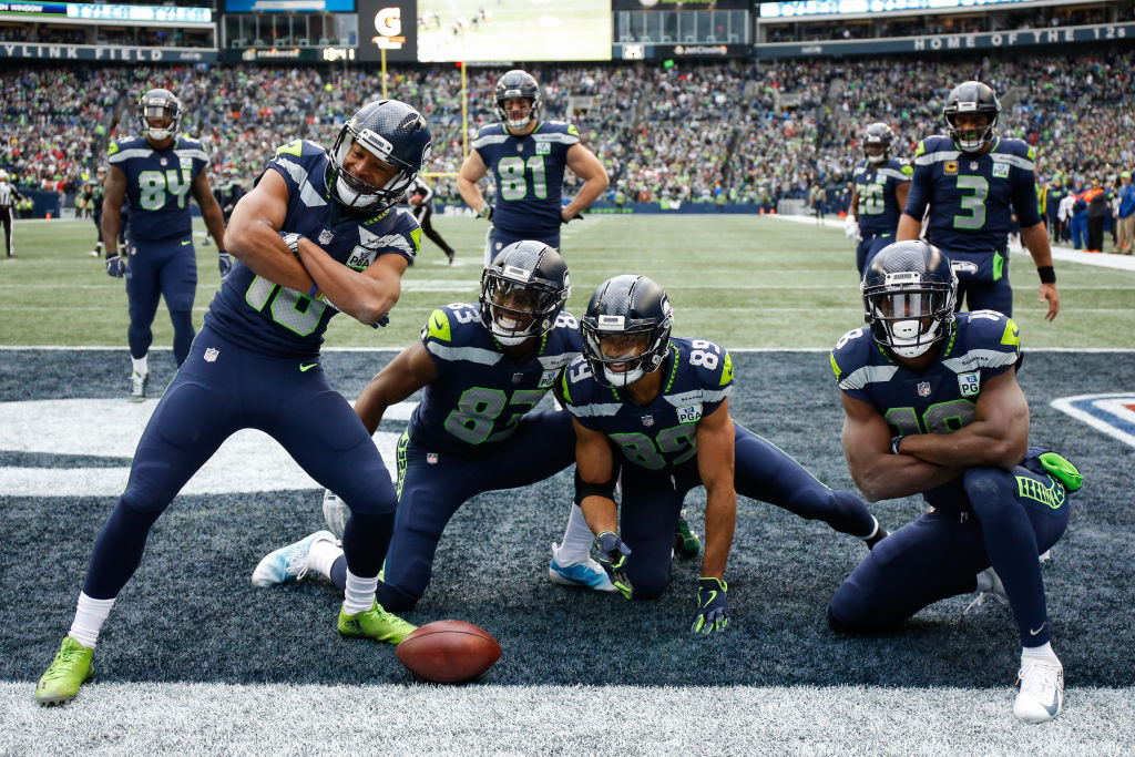 Tyler Lockett #16 of the Seattle Seahawks celebrates a second quarter touchdown with teammates