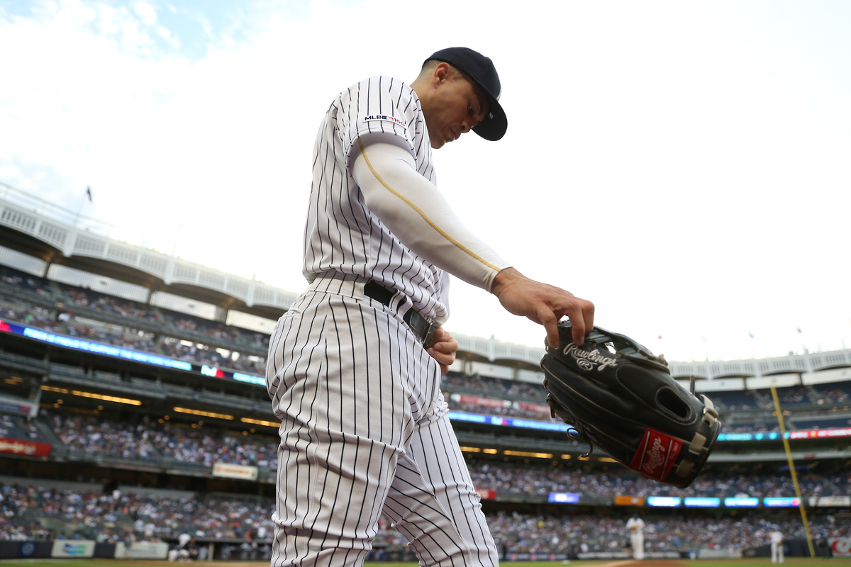 Giancarlo Stanton #27 of the New York Yankees takes the field against the Toronto Blue Jays, 2019