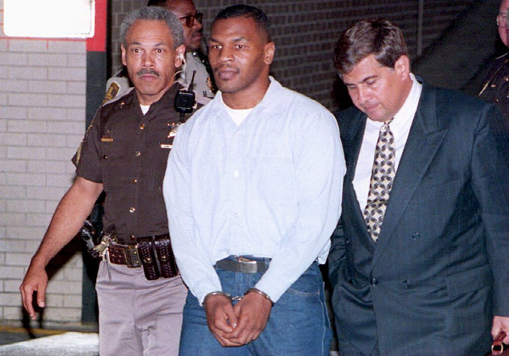 Convicted rapist Mike Tyson (C) leaves the Marion County Courthouse in Indianapolis