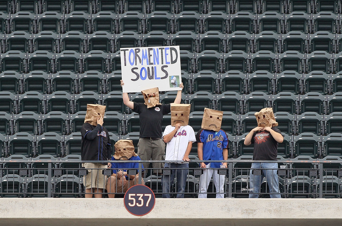 Fans of the New York Mets sit alone in the upper deck during the game against the Cincinnati Reds at Citi Field on September 28, 2011 in the Flushing neighborhood of the Queens borough of New York City.