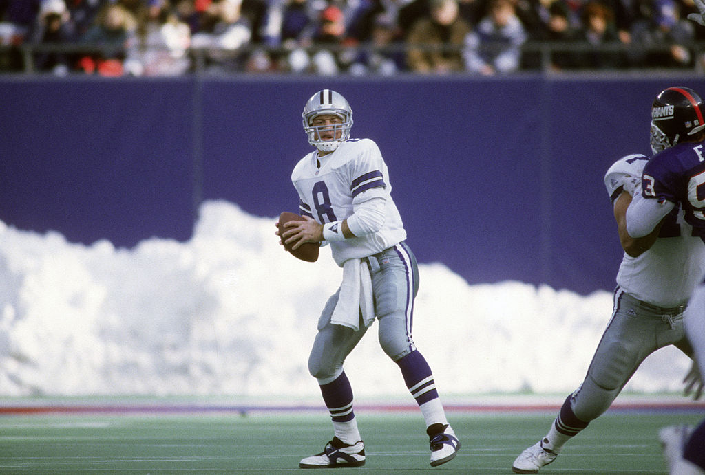 Quarterback Troy Aikam #8 of the Dallas Cowboys drops back to pass against the New York Giants during an NFL football game January 2, 1994 at Giants Stadium in East Rutherford, New Jersey. Aikman played for the Cowboys from 1989-00