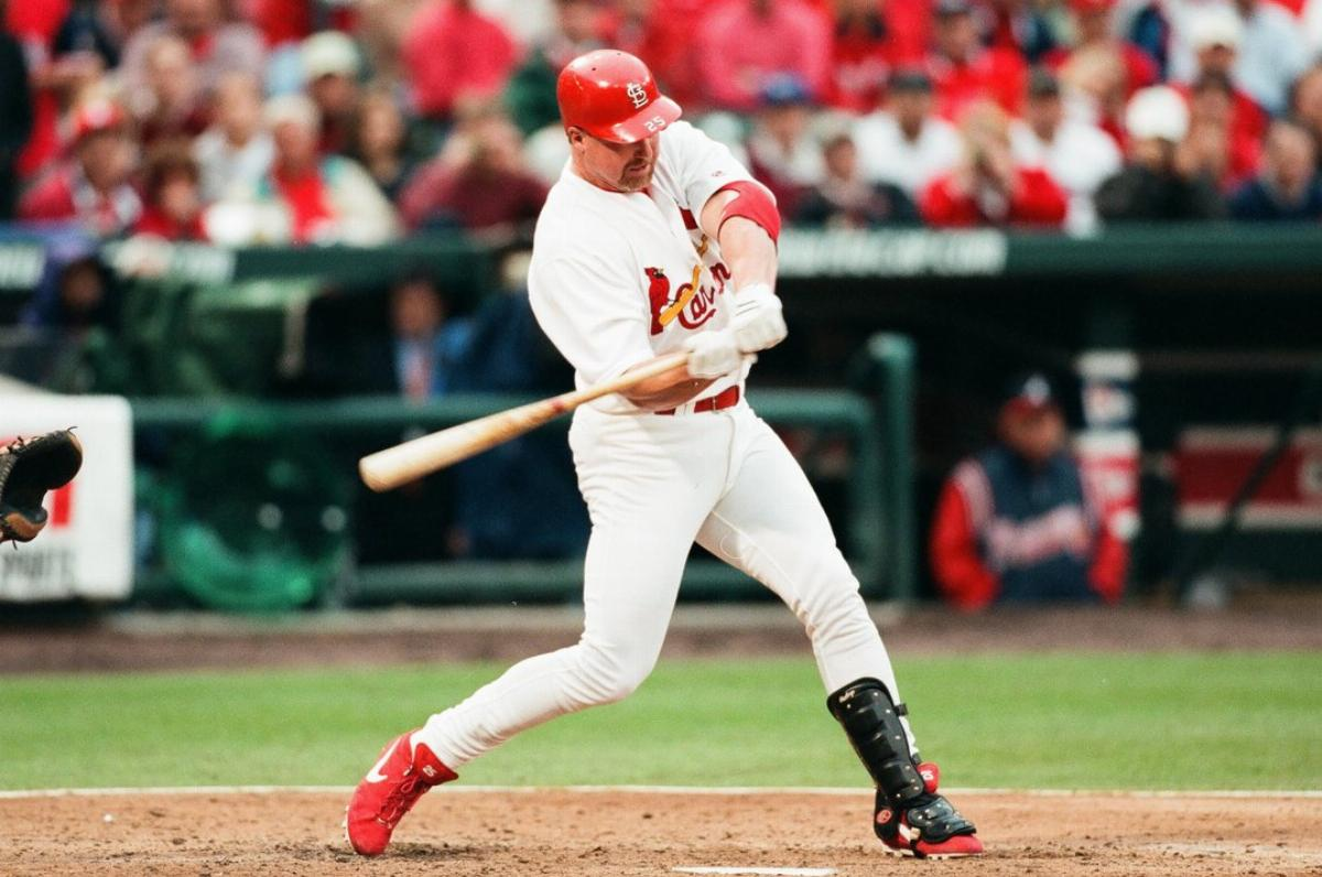 Mark McGwire of the St. Louis Cardinals bats against the Atlanta Braves in 2000