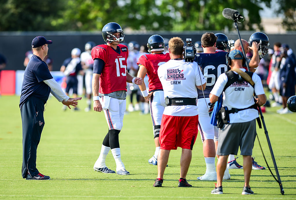 Houston Texans Head Coach Bill O'Brien provides instruction to Houston Texans Quarterback Ryan Mallett (15) while the HBO Series Hard Knocks crew tapes