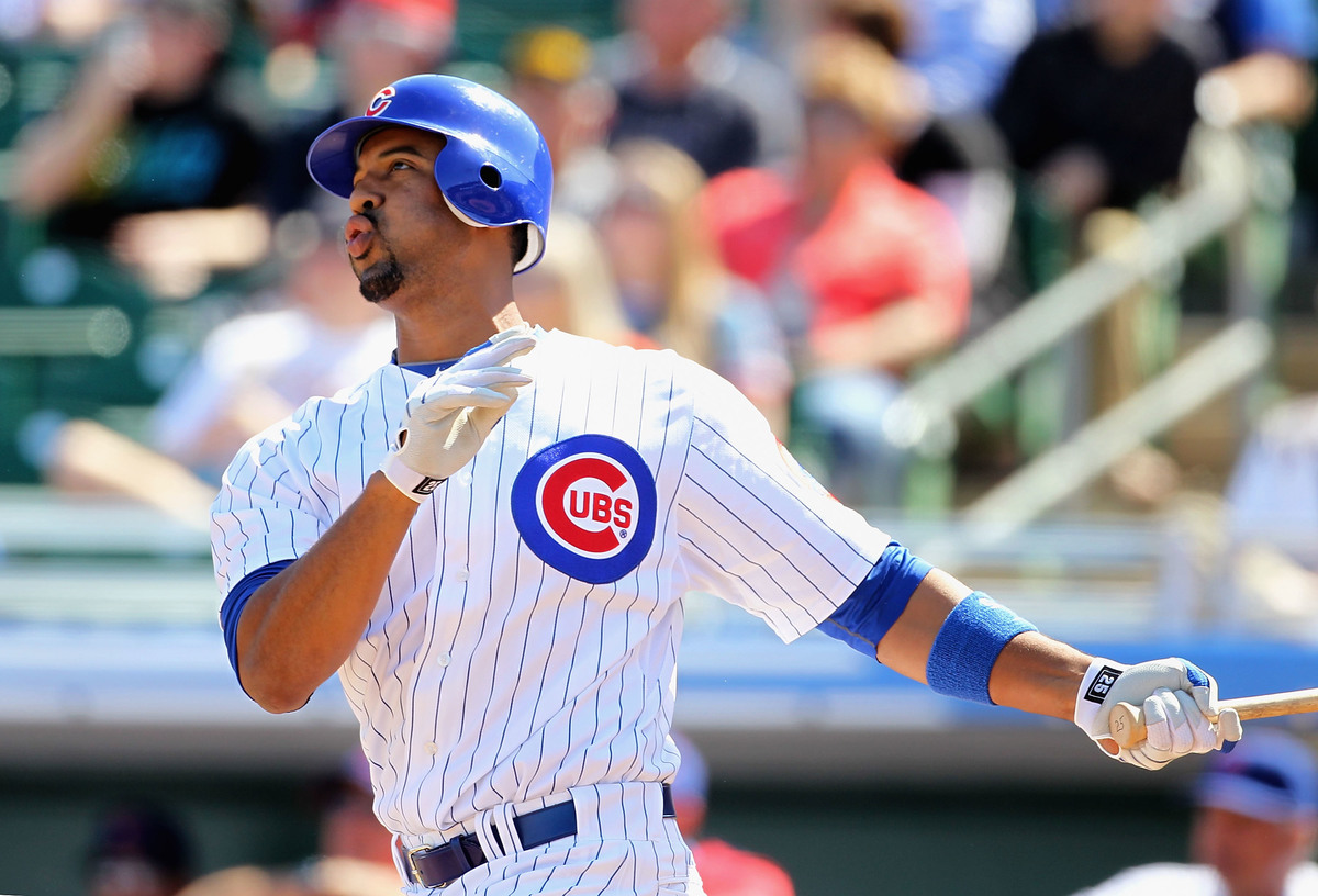 Derrek Lee #25 of the Chicago Cubs hits a solo home run against the Oakland Athletics