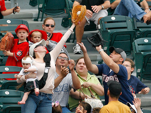 mom catches foul ball with baby in hand